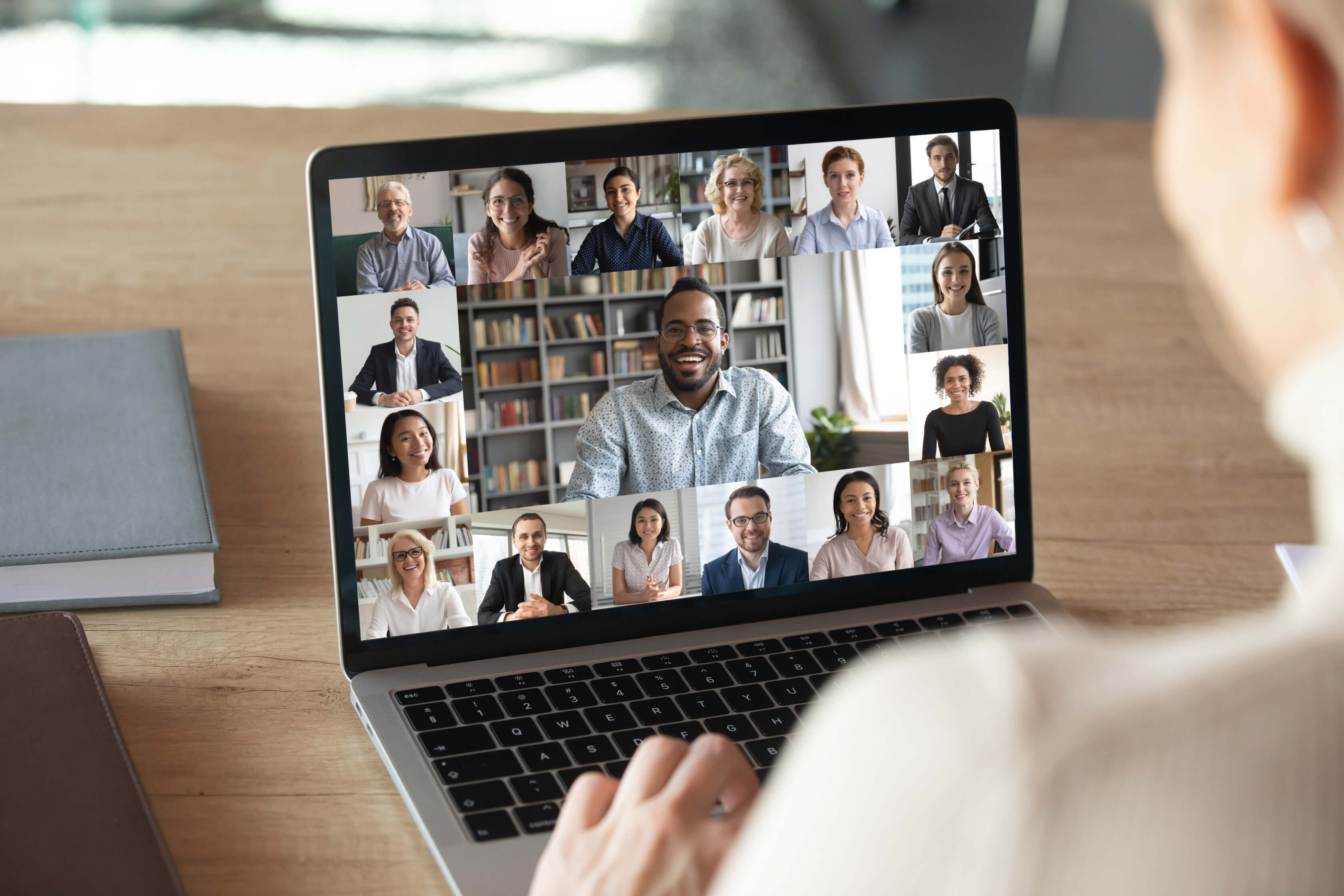 laptop shows members in a video conference